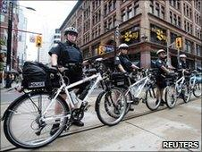 Police line the street ahead of the G20 summit in Toronto, 22 June