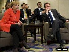 German Chancellor Angela Merkel and UK PM David Cameron watching the England v Germany match in Canada