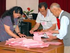 Officials count votes