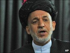 Afghan President Hamid Karzai speaks at a meeting with tribal leaders in Kandahar city, Afghanistan, Sunday June 13, 2010