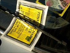 A parking ticket on the windscreen of car