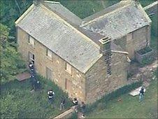 Armed officers storming the disused farm building near Rothbury