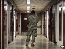 A US guard stands in a corridor in Guantanamo Bay prison (file image)
