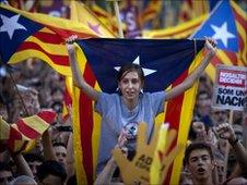 Demonstrators hold Catalan flags and shout slogans as they take part in protest in Barcelona, Spain, Saturday, July 10, 2010