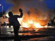 Car burning during rioting in the Ardoyne area of north Belfast