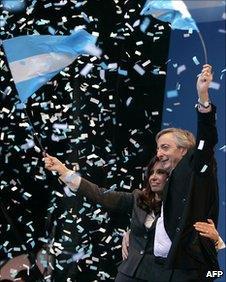 Cristina Fernandez de Kirchner and her husband at a 2008 rally