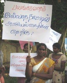 """Protest last year in the northern Sri Lankan town Vavuniya, the placard says """"what is the need to keep poltical prisoners when there's no terrorism"""""""