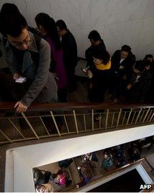 Journalists walk up stairs to the main hall inside the Great Hall of the People