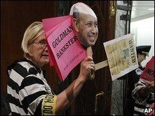 A protester at a Senate hearing on Goldman Sachs