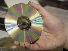 Hand holding CD