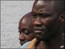 Tiwonge Chimbalanga, right, and Steven Monjeza are led from court in Blantyre on 20 May 2010