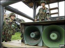 South Korean soldiers stand by loud-speakers at a guard post near the demilitarised zone on 24 May 2010