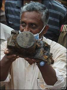 Investigator holds the Air India plane's flight data recorder