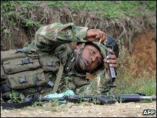 A soldier reloads his rifle during a gunfight with Farc rebels in Corinto in the department of Cauca on 30 May