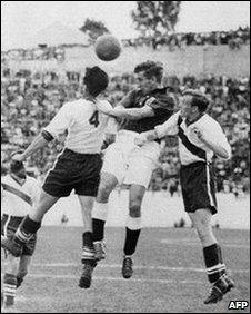 English midfielder Tom Finney (C) tries to head the ball between US defenders Charlie Colombo and Walter Bahr, 29 June 1950