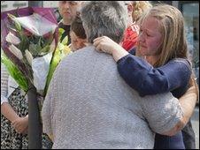 Relatives of Darren Rewcastle visit the scene of his murder