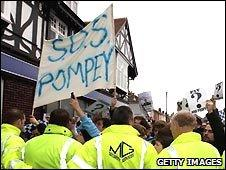 Portsmouth fans protest as the club goes into administration