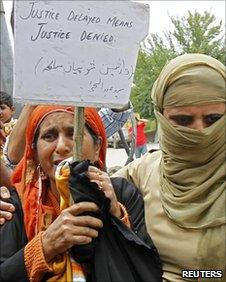 A policewoman (right) detains a woman during a protest in Srinagar on June 7, 2010