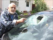 Kenneth Hendy with his damaged car