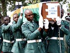Soldiers carry coffins during the burial in Abuja, Nigeria, of the soldiers killed in an African Union peacekeeping mission in Darfur on 29 September 2007
