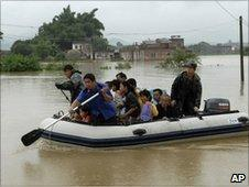 Residents are evacuated after heavy rains caused floods in Huaiji in Guangdong province, China, on 15 June, 2010
