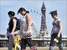 Holidaymakers on the beach in Blackpool