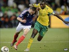 France's Franck Ribery, left, and South Africa's Aaron Mokoena jostle for the ball - 22 June 2010