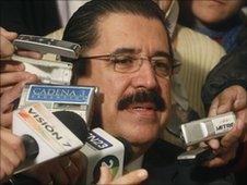 Manuel Zelaya speaks to journalists during a visit to Argentina in May 2010