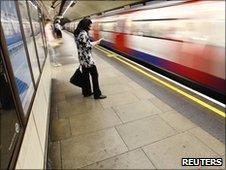 A passenger waits for a Tube train