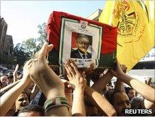 Mourners bear the coffin of Mohammed Oudeh through Yarmouk refugee camp, Syria, 3 July