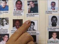 A woman points at pictures of Cuban political prisoners. Photo: June 2010