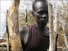 A man rebuilding his house in Abyei