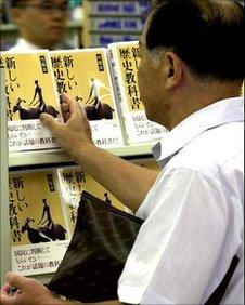 Man looking at a book