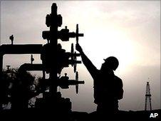 "Worker checks pipes at PetroChina""s Tarim Oilfield in Xinjiang."