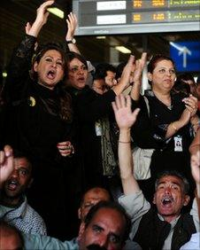 Employees of the flagship Pakistan International Airlines (PIA) chant slogans against the management at the airport in Karachi on February 8, 2011