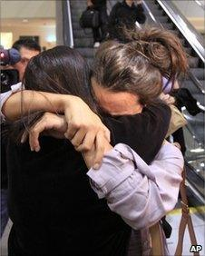 An unidentified Southwest Airlines flight 812 passenger, right, is hugged by a loved one after arriving at Sacramento International Airport Friday, April 1, 2011.