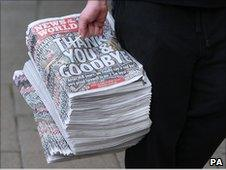 Stack of News of the World papers
