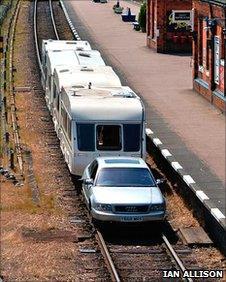 Car pulls caravan at Great Central Railway