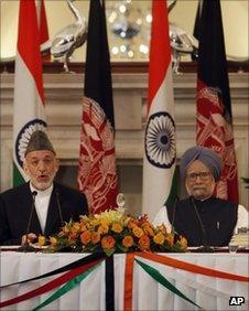 President Hamid Karzai (left) and Indian PM Manmohan Singh