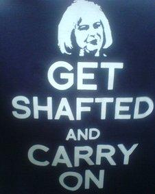 """""""Get shafted and carry on"""" T-shirt being worn by protesting police officers"""