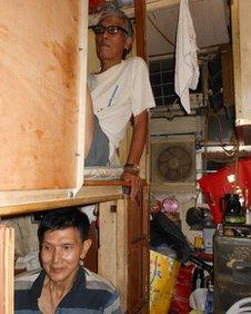 """Mr Wong (above) and Mr Lee live in bunk bed accommodation called """"coffin homes"""""""