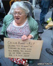 A protester in London was seen carrying a banner for Cecilia Burns at the protest outside Atos HQ