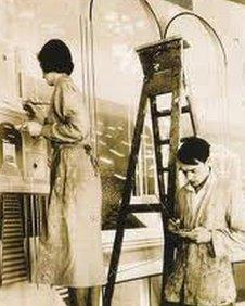 Eric Ravilious and wife Tirzah working on the mural