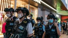 Riot police wearing protective masks patrol during a demonstration outside a shopping mall in Hong Kong