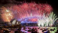 Fireworks explode over the harbour and the Sydney Harbour Bridge landmark during New Year celebrations in Sydney, Australia