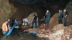 Thai soldiers pumping flooded water out of the cave complex during a rescue operation