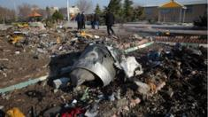 Rescue teams work amid wreckage after a Ukrainian plane crashed in Tehran on 8 January, 2020.