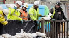Workers construct flood defences in the Upper Calder Valley in West Yorkshire