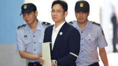 وريث سامسونغ بين شرطيين