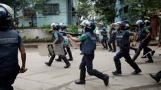 Police fire tear gas shells during a protest over recent traffic accidents that killed a boy and a girl, in Dhaka